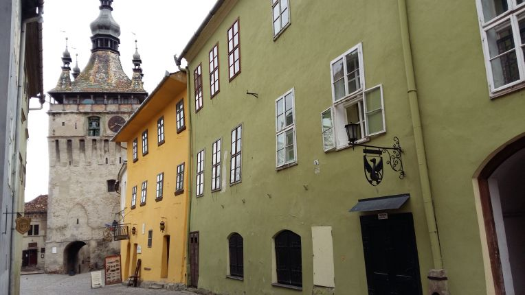 The birthplace of Vlad th Impaler (the yellow house) and the clock tower in Sighisoara