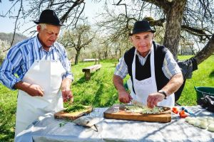 Local hosts preparing the food.